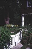 view [Flowerside Inn]: garden gate looking northeast toward rudbeckia. digital asset: [Flowerside Inn]: garden gate looking northeast toward rudbeckia.: 1999.