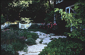 view [Flowerside Inn]: herbs planted within stepping stones. digital asset: [Flowerside Inn]: herbs planted within stepping stones.: 1995.