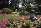 view [Windwood Garden]: formal front entrance garden with fountain, decorative lanterns and benches. digital asset: [Windwood Garden]: formal front entrance garden with fountain, decorative lanterns and benches.: 2007 Sep.