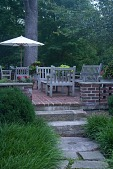 view [Michael Garden]: stone walkway lined with liriope leads to patio seating area. digital asset: [Michael Garden]: stone walkway lined with liriope leads to patio seating area.: 2012 Jul.