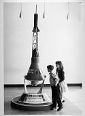 view Visitors looking at Project Mercury Capsule, National Air Museum digital asset number 1