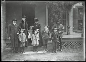 view Family on Front Porch digital asset: Positive image from a glass plate negative by Walter J. Hussey, Family on front porch