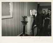 view Andy Warhol Inspects Shoemaking Machine Patent Model While on Castle Tour digital asset number 1