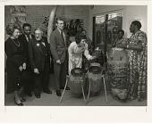 view Joan Mondale Plays Drums at Museum of African Art digital asset number 1