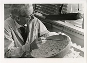 view Preparator Andreas Joseph Andrews Works on a Pottery Bowl digital asset number 1