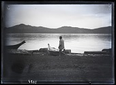 view Kwakiutl Indian Man on Shore at Fort Rupert Settlement with Canoe in Background digital asset number 1