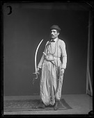 view Fares A. Ferzan Models Syrian Costume with Sword and Dagger digital asset number 1