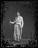 view Fares A. Ferzan Models Syrian Costume with Sword, Dagger, and Rifle digital asset number 1