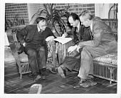 view Gregory Breit (1899-1951) (left), Enrico Fermi (1901-1954) (center), and George Gamow (1904-1968) (right) digital asset number 1