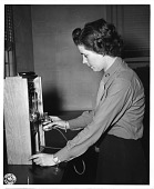 view Margaret V. Dunham, standing at bank of instruments, 1943 digital asset number 1