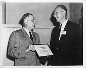 view Captain Isidor Edward Rittenburg (left) presents the Dr. Samuel M. Burka Award to Dr. Donald A. Gordon (right) digital asset number 1