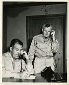 view Major General Leslie R. Groves (seated) with his assistant Brigadier General Thomas F. Farrell digital asset number 1