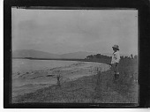 view China, Miscellaneous Scenes - Man in pith helmet standing next to river digital asset number 1