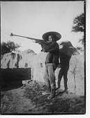 view China, Miscellaneous Scenes - Man posing with gun digital asset number 1