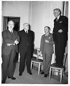 view Standing (left to right): Edmund Ezra Day (1883-1951), U.S. Senator Elbert Duncan Thomas (1883-1953), Harlow Shapley (1885-1972). Standing on chair: Kirtley Fletcher Mather (1888-1978) digital asset number 1