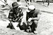 view Curator Doug Owsley and Archaeological Dig Team Member Examine Bone at Antietam digital asset number 1