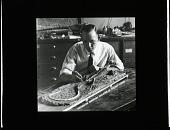 view Preparator Norman Boss Mounting Skeleton of Extinct Lizard digital asset number 1