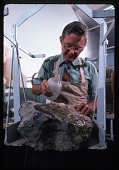 view Dr. Richard E. Grant Examines Fossil in Matrix digital asset number 1