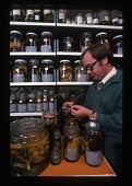 view Frank Greenwell Examining Specimens digital asset number 1