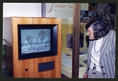 "view Roxie Laybourne Looking at Video Screen in ""Feather Focus"" Exhibit digital asset number 1"