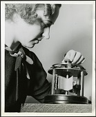 view Dr. Ruby Worner operates a crease meter in a textile laboratory at the U.S. National Bureau of Standards digital asset number 1