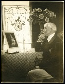 view Photographs - Items 6-7 digital asset: John Gellatly looking at woman's picture (item 6). (Image no. SIA2016-009614)