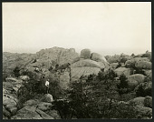 view Rock Formations - Man Stands before Granite Boulders digital asset number 1
