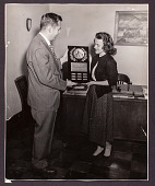 view Mrs. Elaine M. Kilbourne and unidentified man holding her American Chemical Society Award digital asset: Mrs. Elaine M. Kilbourne and unidentified man holding award