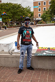 view Protester pose by fountain digital asset: Protester pose by fountain