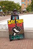 """view Protester holding """"Say Their Names"""" sign digital asset: Protester holding """"Say Their Names"""" sign"""