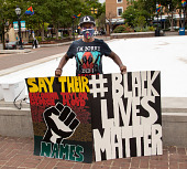 """view Protester  holding """"Say Their Names"""" and Black Lives Matter"""" signs digital asset: Protester  holding """"Say Their Names"""" and Black Lives Matter"""" signs"""