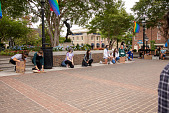view Protesters kneel in honor of George Floyd before the protest rally digital asset: Group kneels in honor of George Floyd before the rally
