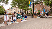 view Protesters kneel in honor of George Floyd before the protest rally digital asset: Protesters kneel in honor of George Floyd before the protest rally