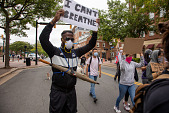 """view Protester  holding """"I Cant Breathe"""" sign digital asset: Man holding """"I cant breathe"""" sign"""