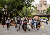 view Protestors marching holding signs digital asset: Protestors marching holding signs
