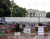view Protest posters affixed to barriers near the White House digital asset: Protest posters affixed to barriers near the White House