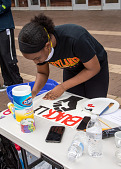 """view Young woman creating a """"Black Lives Matter"""" sign digital asset: Young woman creating a """"Black Lives Matter"""" sign"""