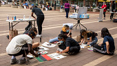 view Youth creating signs for Black Lives Matter protest digital asset: Group of people creating signs