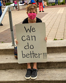 """view Woman sitting on steps holding """"We can do better!!!"""" sign digital asset: Woman sitting on steps holding """"We can do better!!!"""" sign"""