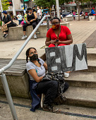 """view Young woman holding """"BLM"""" sign digital asset: Young woman holding """"BLM"""" sign"""