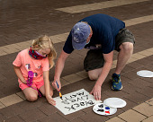 """view Man and child creating a """"Black Lives Matter"""" sign digital asset: Man and child creating a """"Black Lives Matter"""" sign"""