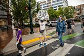 "view Man holding ""Black Lives Matter"" sign digital asset: Man holding ""Black Lives Matter"" sign"
