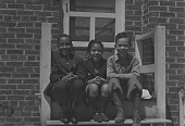 view Herman, Anne, and Jack sitting on porch digital asset: Herman, Anne, and Jack sitting on porch