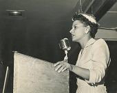 view Thelma D. Perkins speaking at podium digital asset: Thelma D. Perkins speaking at podium