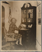 view Mrs. Catherine Bryan sitting at her desk digital asset: Mrs. Catherine Bryan sitting at her desk