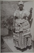 view Woman adorned as Iyansã, wife of Sangõ, the Yoruba god of thunder digital asset: Woman adorned as Iyansã, wife of Sangõ, the Yoruba god of thunder