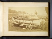 "view Albumen photograph of a man, possibly the balloonist Washington Harrison Donaldson, standing in a boat mounted on a wagon with several policemen standing to the right of the boat. Lettering on the boat reads ""Built [for] the Balloon Expedition of the D... digital asset: Albumen photograph of a man, possibly the balloonist Washington Harrison Donaldson, standing in a boat mounted on a wagon with several policemen standing to the right of the boat. Lettering on the boat reads ""Built [for] the Balloon Expedition of the Daily Graphic ... Ingersoll 159 South St. N.Y."""