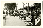 view [Many people selling goods on a sidewalk in Mexico]. [black-and-white print] digital asset: [Many people selling goods on a sidewalk in Mexico]. [black-and-white print]