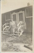 view [Woman standing outside barracks : black-and-white photoprint] digital asset: Relocation handbook; silver photoprint of Vogel at barracks