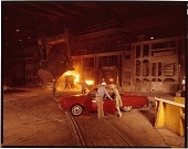 view Blast furnaces and loading docks (ore) with Thunderbirds [476A]. digital asset: Blast furnaces and loading docks (ore) with Thunderbirds [476A].